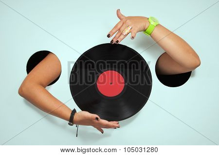 Vinyl in a female hands
