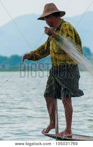 Fisherman at Inle Lake working on one foot