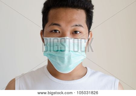 Asian Man Wearing A Face Mask