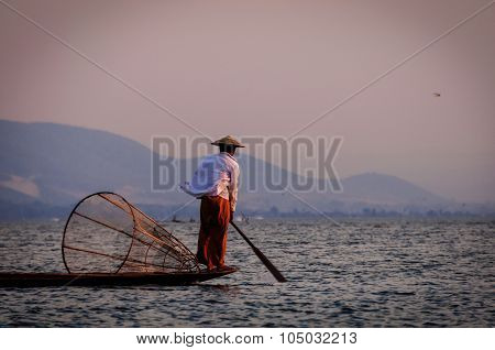 Inle Lake Fisherman rowing with foot