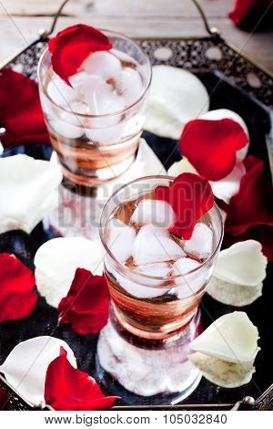Rose flavor cocktail with petals