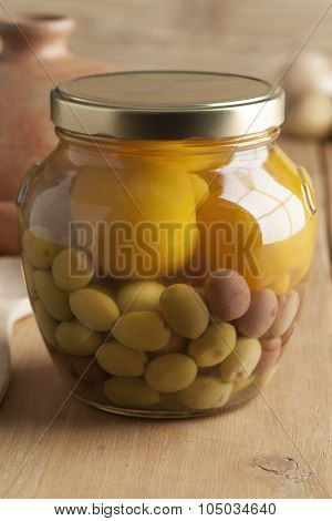 Moroccan glass jar with preserved olives and lemons