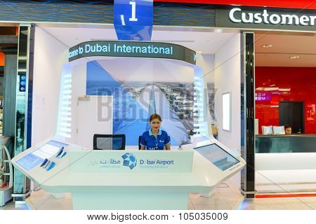 DUBAI, UAE - JUNE 04, 2014: information desk in Dubai Airport. Dubai International Airport is the primary airport serving Dubai and is the world's busiest airport by international passenger traffic.