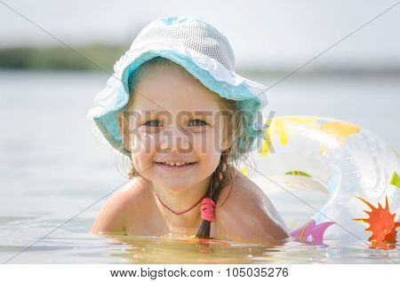 Happy Four-year Girl Bathes In The River