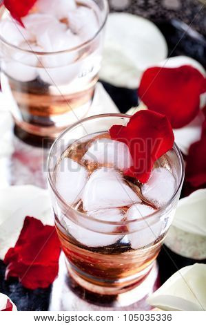 Rose flavor cocktail petals on a vintage tray