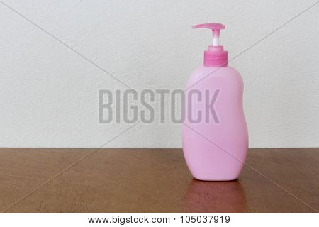 Pink Bottles Of Health And Beauty Products Cosmetic On The Wood