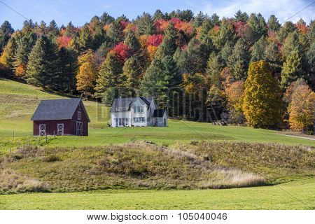 A beautiful generic New England country building in the fall