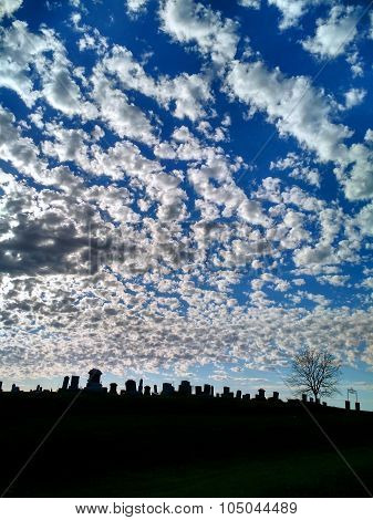 Cemetery Tombstone Skyline Silhouette Against Dramatic Clouds