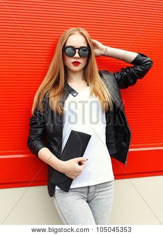 Fashion Portrait Pretty Blonde Woman Wearing A Rock Black Leather Jacket, Sunglasses And Handbag Clu