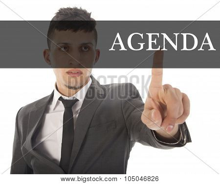 Young Businessman With Text Agenda Isolated On White Background