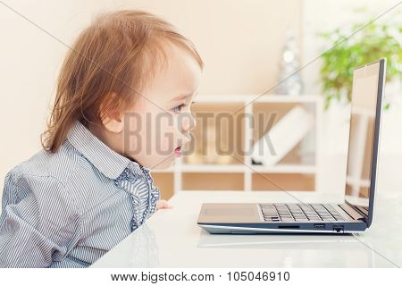 Little Toddler Girl Amazed At Something She See On Her Laptop