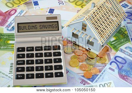 The Words Building Savings On Calculator Display