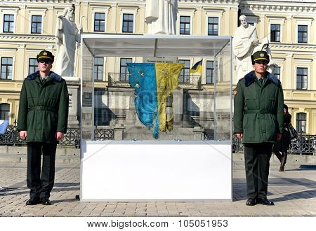 Kiev, Ukraine,  Michael's Square, October 16, 2015. The exhibition of military equipment, on the Day of Defender of Ukraine. Ukrainian flag from the field of combat operations