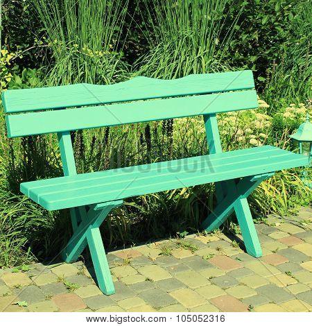 Wooden Park Bench At The Summer Garden