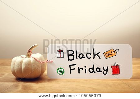 Black Friday Message With A White Pumpkin