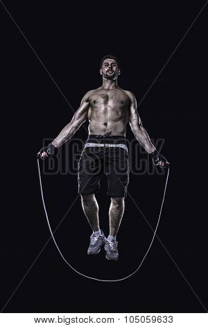 Athlet jumping on skipping rope isolated