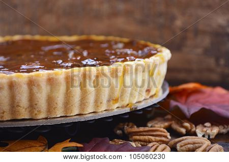 Traditional Thanksgiving Pecan Pie On Dark Wood Background.