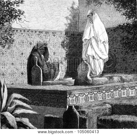 Visit to an Arab tomb. On after a family photograph in Algiers, vintage engraved illustration. Magasin Pittoresque (1882).