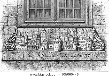 Bas-relief of a house in Dieppe representing the city of Antwerp, vintage engraved illustration. Magasin Pittoresque (1882).