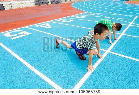 Boy Ready To Start On Racetrack