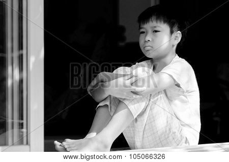 Boy Sit Beside Window