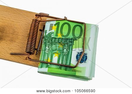 many euro banknotes in a mousetrap. symbolic photo for debt and debt on loans.