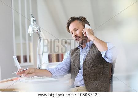 Businessman at work talking on the phone