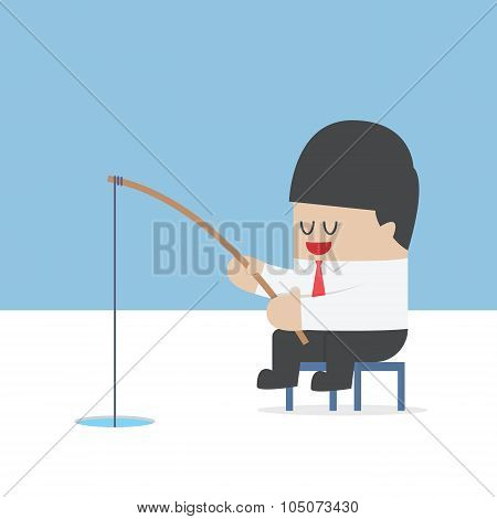 Businessman Fishing From A Hole On Ice