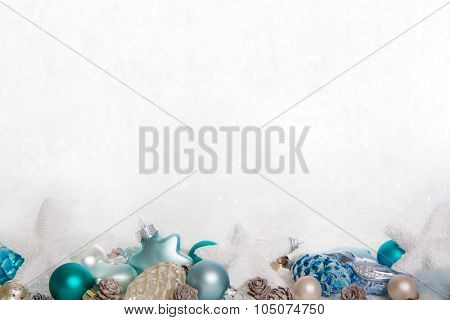 Turquoise and blue wooden snowy white christmas background with balls, stars and hearts for decoration.