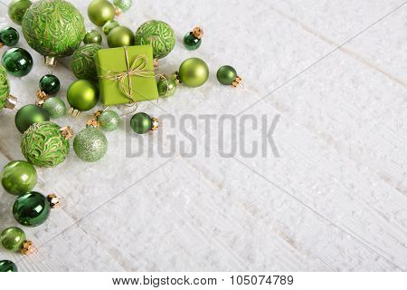 Green and white christmas background with present snow and balls for decoration items.
