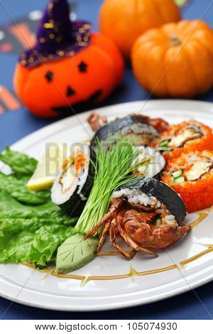 spider roll, maki sushi made of soft shell crab tempura and sushi rice, halloween party dinner