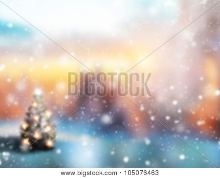 Abstract snowy blur Christmas background with Christmas tree