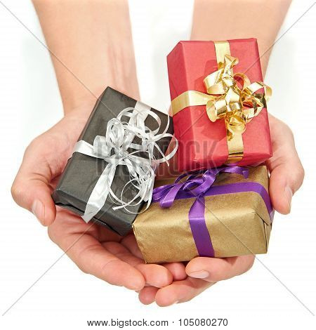 Hands Holding Small Christmas Presents