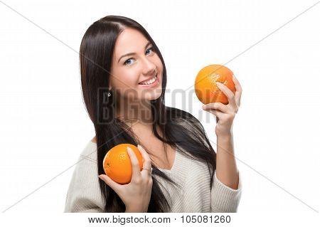 girl holding citrus
