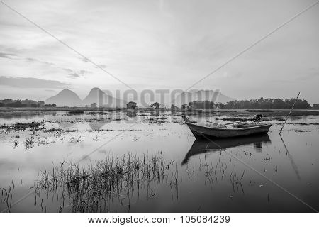 Black And White Nature Landscape Of Beautiful Foggy Morning By The Lake With Fishing Boat