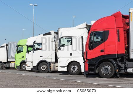 Trucks Are Standing In A Row On The Car Park