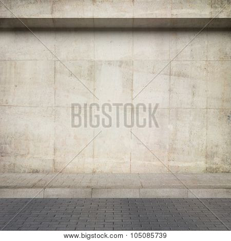 Urban background. Obsolete concrete wall and pavement.