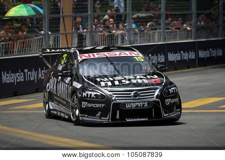 KUALA LUMPUR, MALAYSIA - AUGUST 08, 2015: Todd Kelly from the Nissan Motorsports team races in the V8 Supercars Street Challenge at the 2015 Kuala Lumpur City Grand Prix.