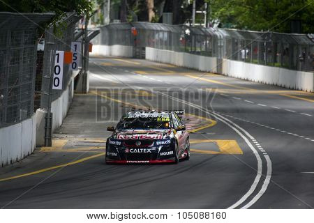 KUALA LUMPUR, MALAYSIA - AUGUST 08, 2015: Craig Lowndes from the Red Bull Racing Australia team races in the V8 Supercars Street Challenge at the 2015 Kuala Lumpur City Grand Prix.