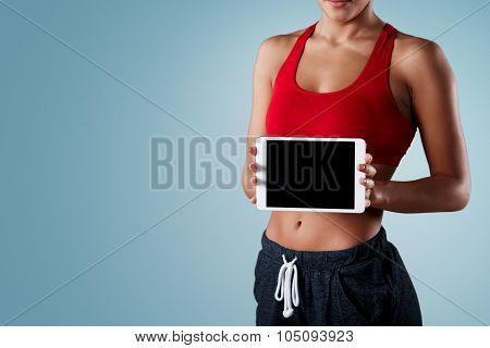 Fitness, Dieting, Technology And Sport Concept - Sporty Mixed Race Woman Showing Tablet Pc Blank Bla