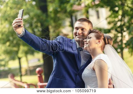 Bride And Groom Make Selfie