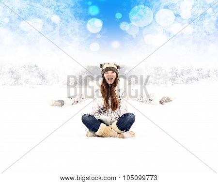 Model In Coat And Hat Sitting At The Winter Seaside