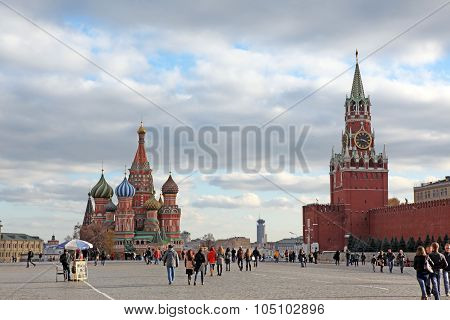 Moscow - Oct 22: People At Red Square With Saint Basil Cathedral And Spasskaya Tower In Moscow On Oc