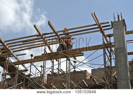 A construction worker fabricate beam formwork