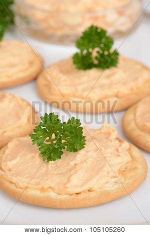 macro crackers with salmon pate and parsley shallow DOF
