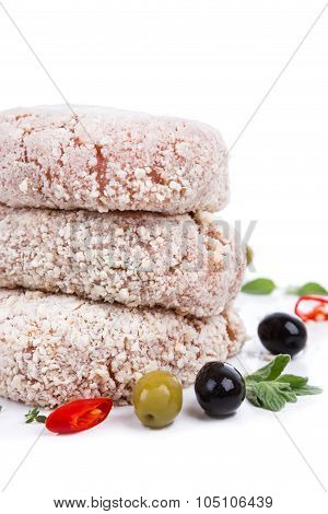 Three Raw Cutlet With Breading From On Side