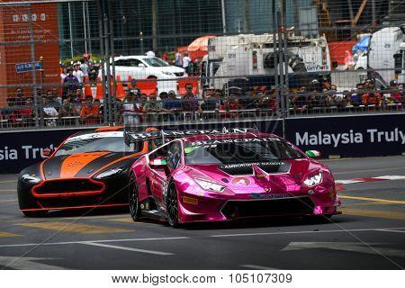 KUALA LUMPUR, MALAYSIA - AUGUST 08, 2015: Naoki Yokomizo drives a Lamborghini Super Trofeo LP620 car (front) races in the KL City GT CUP Race, at the 2015 Kuala Lumpur City Grand Prix.