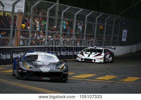 KUALA LUMPUR, MALAYSIA - AUGUST 08, 2015: Adrian D'Silva drives a Ferrari 458 GT3 (front) car leads on turn 2 in the KL City GT CUP Race of the 2015 Kuala Lumpur City Grand Prix.