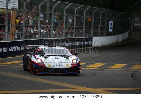 KUALA LUMPUR, MALAYSIA - AUGUST 08, 2015: Fairuz Fauzy drives a Lamborghini Gallardo FL2 GT3 car  takes turn 2 of the city streets in the KL City GT CUP Race of the 2015 Kuala Lumpur City Grand Prix.