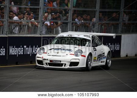 KUALA LUMPUR, MALAYSIA - AUGUST 08, 2015: Wong Kian Kuan drives a Porsche 997 Cup car takes turn 2 in the KL City GT CUP Race of the 2015 Kuala Lumpur City Grand Prix.